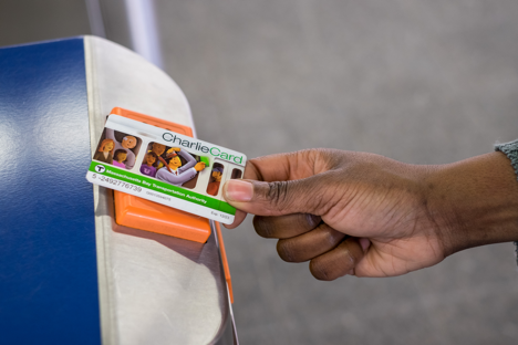 Customer scanning a CharlieCard at a fare entry gate