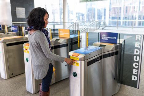 Customer scanning into a fare gate
