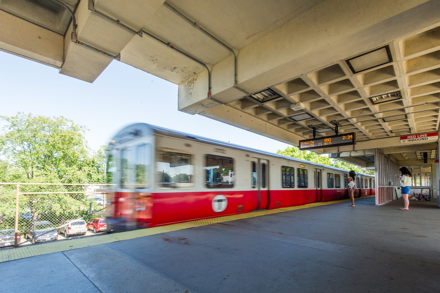 Red Line train departing from Wollaston Station during the day