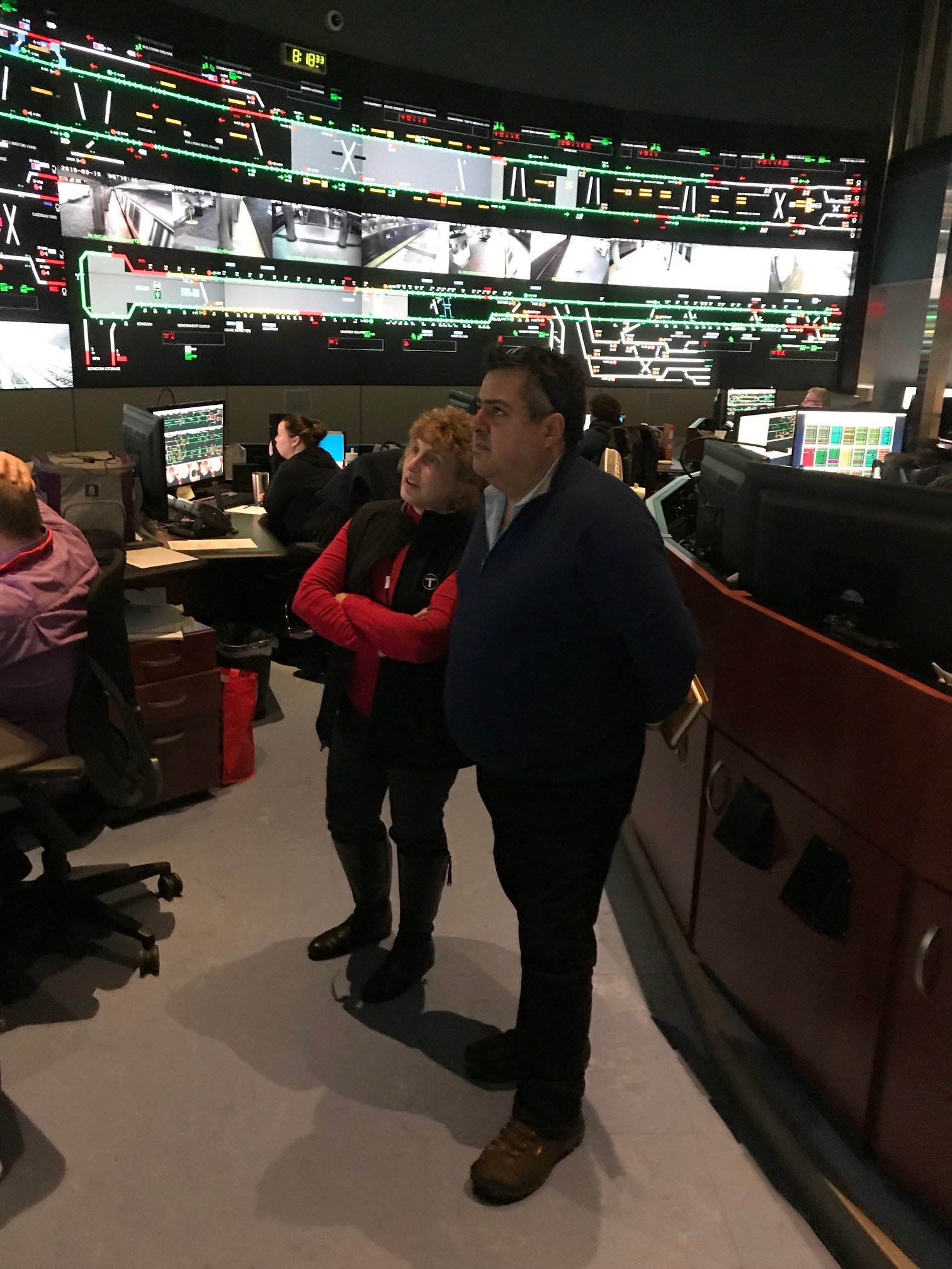 On Tuesday morning, MassDOT Secretary Stephanie Pollack and MBTA General Manager Luis Manuel Ramírez stand together, monitoring the screens at the Operating Control Center.