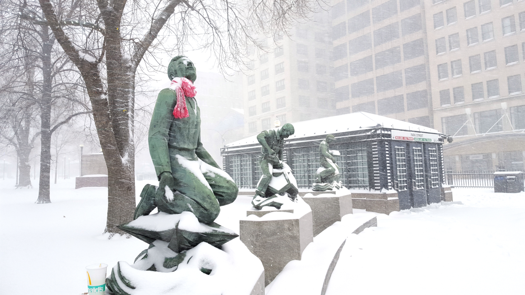 A photo of statues outside Park Street Station, covered in snow during the winter storm on January 4, 2018.